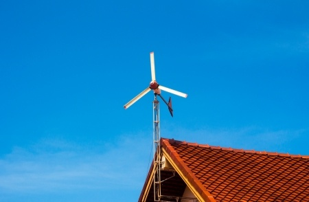 Roof mounted wind turbine generating free electricity